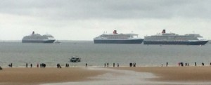 Three Queens sail in to the River Mersey in majestic formation