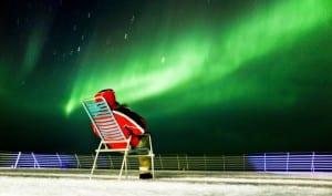 Hurtigruten man on deck Northen lights